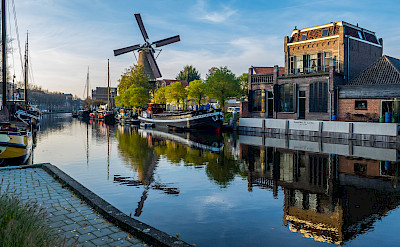 Harbor and windmill in Gouda, South Holland, the Netherlands. Flickr:Frans Berkelaar