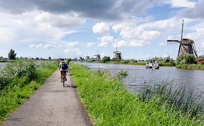 Biking the beautiful windmill region of Kinderdijk, South Holland, the Netherlands. Flickr:Luca Casartelli