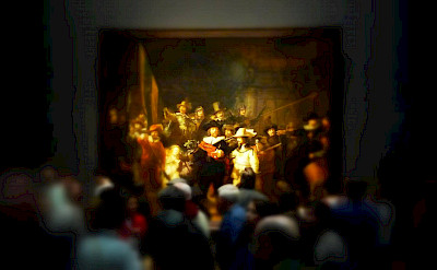 "Rembrandt's famous ""Night Watch"" in the Rijksmuseum, Amsterdam. Photo via Flickr:Neil Thompson"