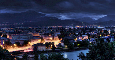 Innsbruck at night in Tyrol, Austria. Photo via Flickr:Alex Holzknecht