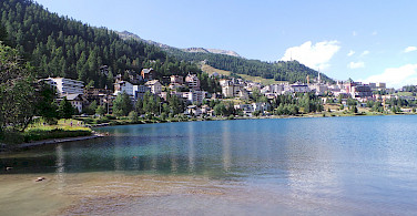 St Moritz along the lake in Switzerland. Photo via Flickr:Luca Viscardi