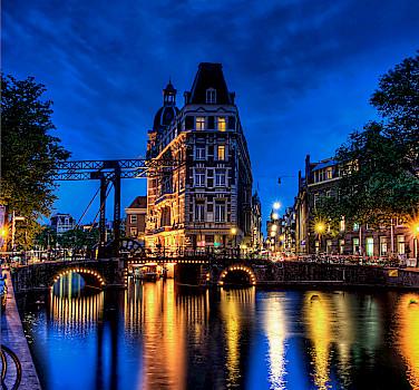Amsterdam at dusk, North Holland, the Netherlands. Photo via Flickr:Elyktra