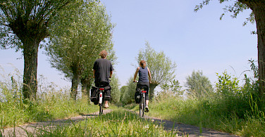 Cycling along Holland's many quiet bikepaths. Photo courtesy of the Netherlands Board of Tourism
