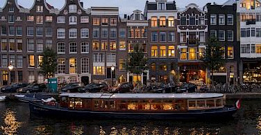 Nighttime in Amsterdam, North Holland, the Netherlands. Photo via Flickr:briyyz