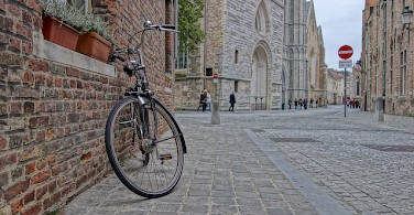 Biking in Bruges, Belgium. Photo via Flickr:nanpalmero