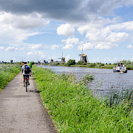 Biking the famous Kinderdijk, South Holland, the Netherlands. Photo via Flickr:Luca Casartelli