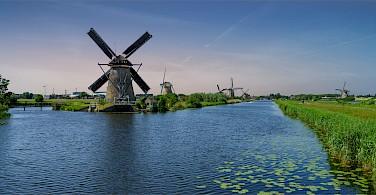 Quiet bike paths in the Kinderdijk, South Holland, the Netherlands. Photo via Flickr:Norbert Reimer