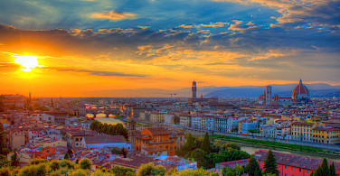 Sunset over Florence, Tuscany, Italy. Photo via Flickr:Jiuguang Wang