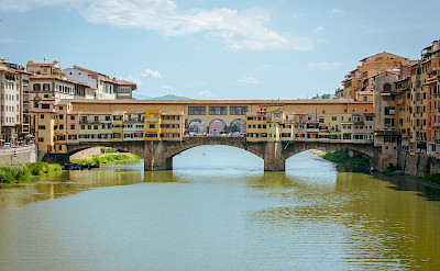 Florence's Ponte Vecchio bridge over the Arno River in Tuscany. ©Photo via TO