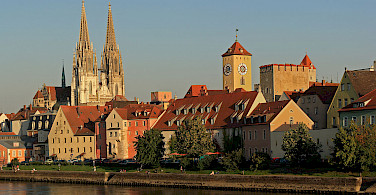 Along the Danube in Regensburg with its Rathaus. Photo via Wikimedia Commons:Avarim