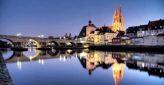 Regensburg at night along the Danube River in Germany. Photo via Creative Commons:Ulrich Oestringer