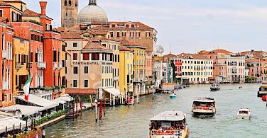 Biking and boating in Venice, Italy. Photo via Flickr:Tambako the Jaguar