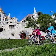 Biking through Budapest. Photo via TO