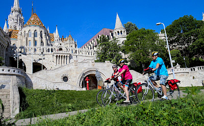 Biking through Budapest. Photo via TO