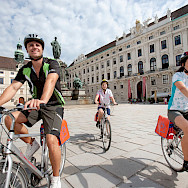 Biking at Hofburg, the Imperial Palace in Vienna, Austria. Photo via TO