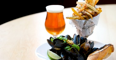 Mussels, fries & Belgian brew. A common treat. Photo via Flickr:cambridgebrewingco