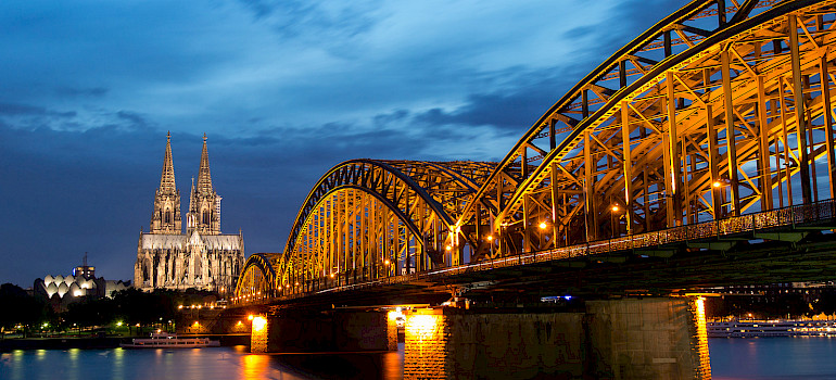 Famous Cathedral and Bridge in Cologne, Germany. Photo via Flickr:Anja Pietsch