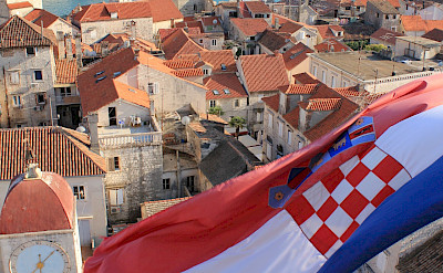 Croatian flag over Trogir, Croatia. Flickr:Jeremy Couture