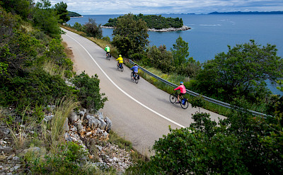 Cycling along the Dalmatian Coast on Korčula Island in Croatia.