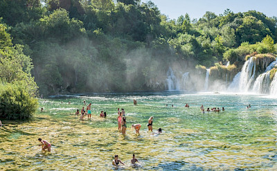 Swimming at Skardin waterfall in Croatia. Flickr:Luca Sartoni