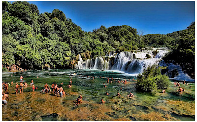 Swimming at the waterfalls at Krka National Park, Croatia. Flickr:Mario Fajt