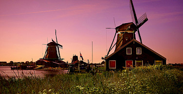Windmills at sunset, Zaanse Schans. Photo via Flickr:Moyan Brenn