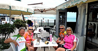 Hennie, Sally and friends taking a break from their ride along the Adriatic Sea in Riccione, Italy. Photo by Sally Fishbeck