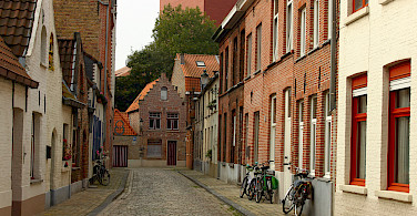 Quiet cobblestone street in Bruges, Belgium. Flickr:Elroy Serrao