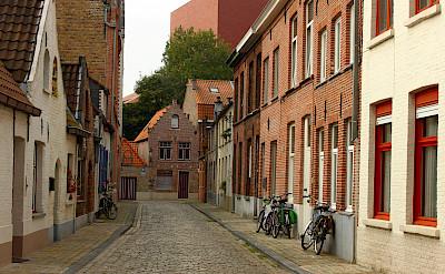 Quiet cobblestone street in Bruges, Belgium. Flickr:Elroy Serrao