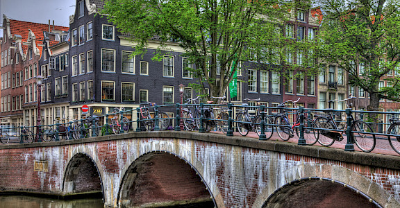 Bikes over the canal bridge in Amsterdam, North Holland, the Netherlands. Photo via Flickr:vgm8383