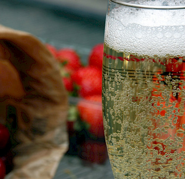 Strawberries and champagne in Epernay, France. Photo via Flickr:Pug Girl