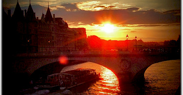Sunset over the Seine in Paris, France. Photo via Flickr:Moyan Brenn