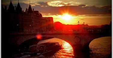 Sunset over the Seine in Paris, France. Photo via Flickr:Moyan Brenn