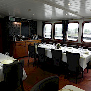 Dinning room on Magnifique | Bike & Boat Tours