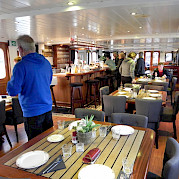 Dinning room set for service on Magnifique | Bike & Boat Tours
