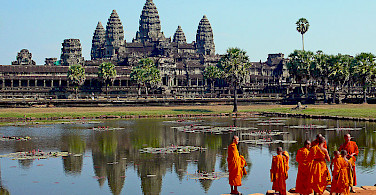 Buddhist Monks in front of the Angkor Wat in Cambodia. Photo via Wikimedia Commons:sam graza