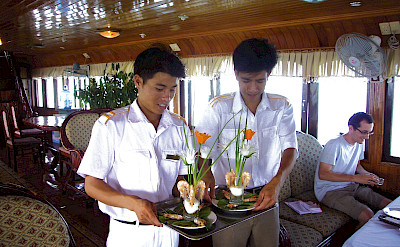 At your service - Vietnamese Junks | Bike & Boat Tours