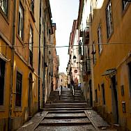Quiet street in Lisbon, Portugal. Flickr:Luca Sartoni