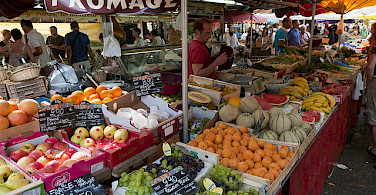 Market in Provence. Photo via Flickr:Michal Osmenda