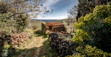 Old stone structures on Cres Island, Croatia. Photo via Flickr:Bernd Thaller