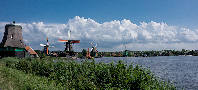 Windmills at the Zaanse Schans Open Air Museum, Zaandam, Holland. Photo via Flickr:kismihok