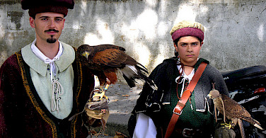 Falconers in Evora. Photo via Flickr:PhillipC