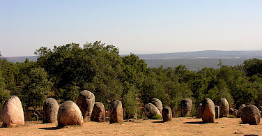 Cork trees and megaliths near Evora. Photo via Flickr:PhillipC