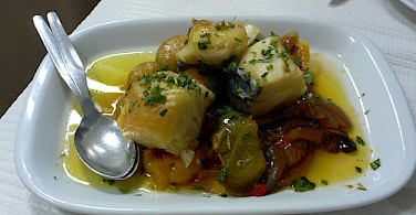 Salt cod with peppers at Casa do Lentejo in Lisbon. Photo via Flickr:heatheronhertravels