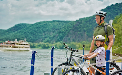 Family biking the Wachau region in Austria. Photo via TO:© Austrian Views / Mooslechner