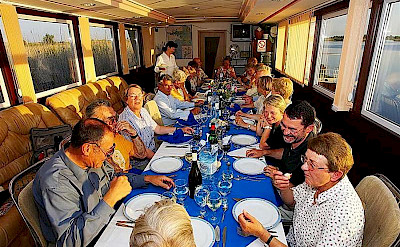 Dining on board the hotel boat.