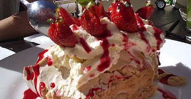 Pavlova is a very traditional dessert in New Zealand! Photo via Flickr:jem