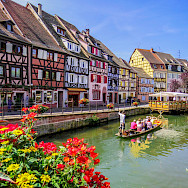 Biking and boat ride along the canal in Colmar, Alsace, France. Photo via Flickr:Kiefer
