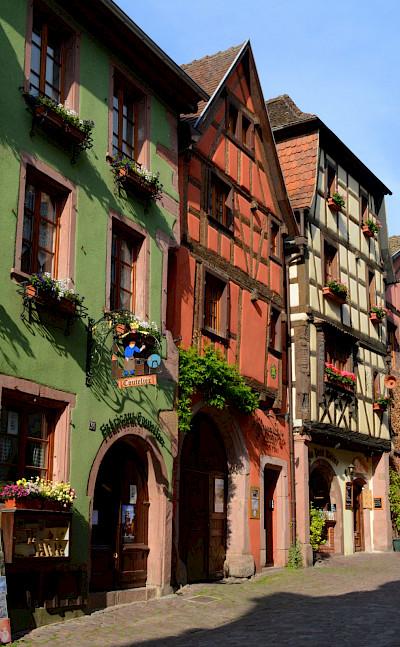 Bike rest in Riquewihr, Alsace Wine Route Tour, France. Photo via Flickr:Pug Girl