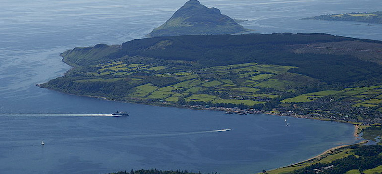 Ferry approaching Brodick pier. Photo via Wikimedia Commons:Clyde Coast